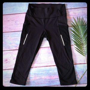 Lululemon black capris with mesh pockets & ankles